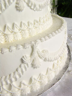 white wedding cake with icing designs